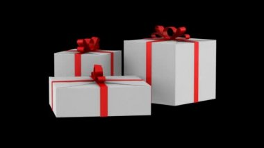 Three white gift boxes with red ribbon and bow loop rotate on black background — Stock Video