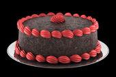 Round chocolate cake with pink cream isolated on black backgroun — Stock Photo
