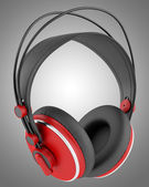 Red and black wireless headphones isolated on gray background — Stock Photo