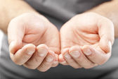 Two male hands as if giving, showing or holding concept — Stock Photo