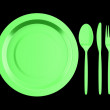 Empty green plate with knife, fork and spoon isolated on black b — Stock Photo