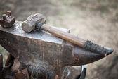 Hammer on blacksmith anvil — Stock Photo