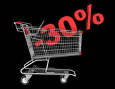 Shopping cart with 30 percent discount isolated on black backgro — Stock Photo