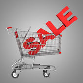 Shopping cart with word sale isolated on gray background — Stock Photo