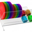 Plate rack with multicolor tableware isolated on white backgroun — Stock Photo