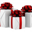 Gift boxes with red ribbons isolated on white background — Stock Photo