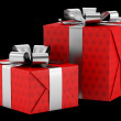 Two red gift boxes with silver ribbons isolated on black backgro — Stock Photo