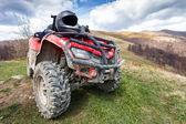 ATV on mountains landscape on a sunny day — Stock Photo