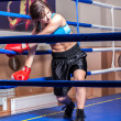 Girl boxer in boxing ring — Stock Photo #13276222
