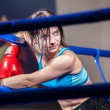 Girl boxer in boxing ring — Stock Photo
