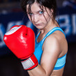 Young and fit female fighter posing in combat poses  — Stock Photo