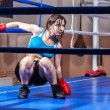 Girl boxer in boxing ring — Stock Photo #13276236