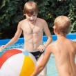 Happiness children at pool — Stock Photo