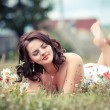 Beautiful happy young woman in the park on a warm summer day  — Stock Photo