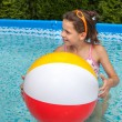 Little girl swimming in pool — Stock Photo