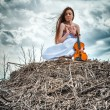 The red-haired girl with a violin outdoor — Stock Photo #13276347