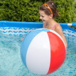 Stock Photo: Little girl swimming in pool