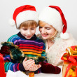 Stock Photo: Happy family with a gifts