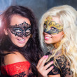 Happy young girls under masks on the party — Stock Photo #13276423