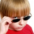 Portrait of the serious boy in dark glasses — Stock Photo