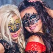 Happy young girls under masks on the party — Stock Photo #13276433