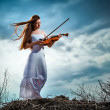 The red-haired girl with a violin outdoor — Stock Photo