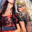 Dance happy young girls under masks on the party — Stock Photo #13276522