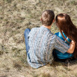 Romantic young couple sitting together in park — Stock Photo #13276543
