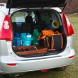 Stock Photo: Hatchback car loaded with open trunk and luggage
