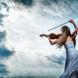 The red-haired girl with a violin outdoor — Stock Photo #13276775