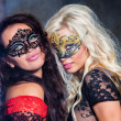 Happy young girls under masks on the party — Stock Photo #13276793