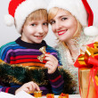 Happy family with a gifts — Stock Photo #13276803