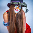 Stock Photo: Portrait of a girl clown with painted face.
