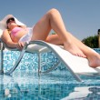 Beautiful woman enjoying summer in the pool - Lizenzfreies Foto