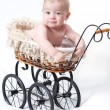 Baby in sitting stroller - Stock Photo