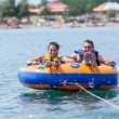Young couiple on water attractions during summer vacations — Stock Photo #13276947