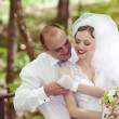 Happy Bride and groom on a wedding day — Stock Photo