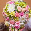 Wedding bouquet of multi-colored flowers - Stock Photo