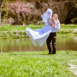Happy Bride and groom on a wedding day - Stock Photo