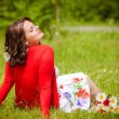 Happy smiling woman with flower - Stock Photo