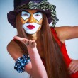 Portrait of a girl clown with painted face. — Stock Photo