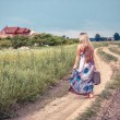 Return of the rural girl to native places - Stock Photo