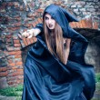 Portrait of a young witch. Halloween, horror. - Foto Stock