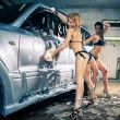 Stock Photo: Models at the car wash in garage. Cross processing
