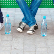 Teens in jeans and sneakers in street — Stock Photo