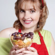The beautiful womenl with fruit salad — Stock Photo