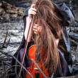 The red-haired girl with a violin sitting on the ashes — Stock Photo