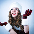 Beautiful miss Santa looking at the snow - Stock Photo