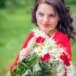 Happy smiling woman with flower  — Stock Photo