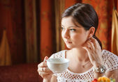 Elegant woman with a tea mug in cafe — Stock Photo